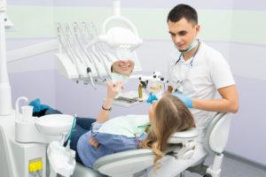 Наращивание зубов винирами